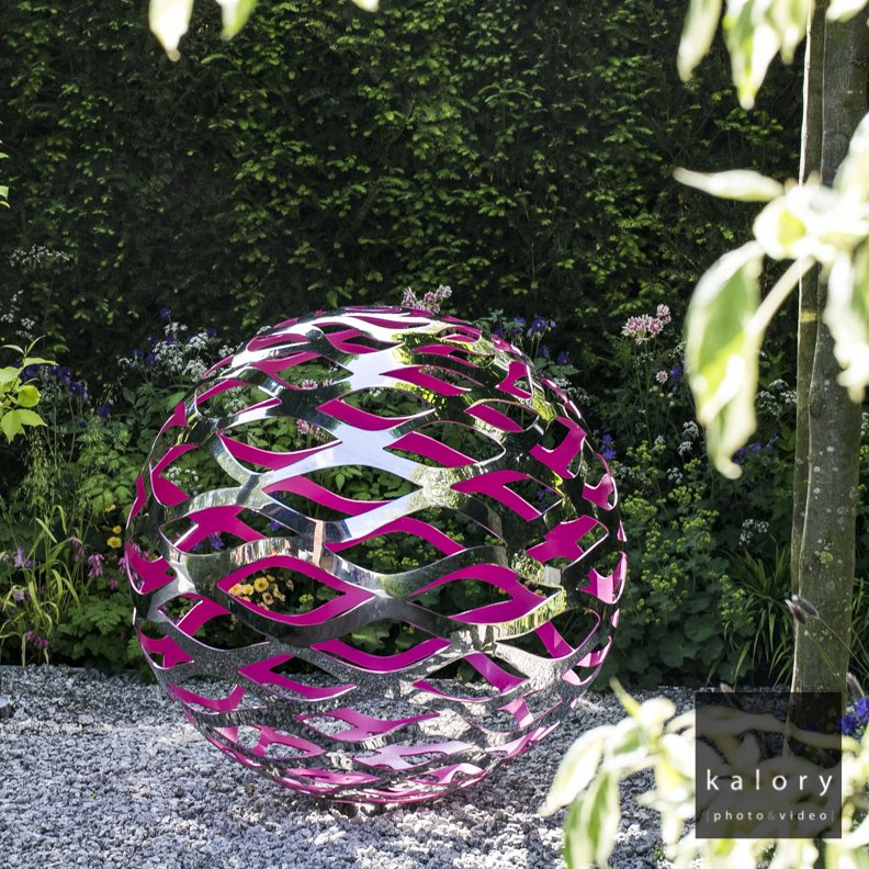 pink and silver ball structure design shot at the chelsea flower show